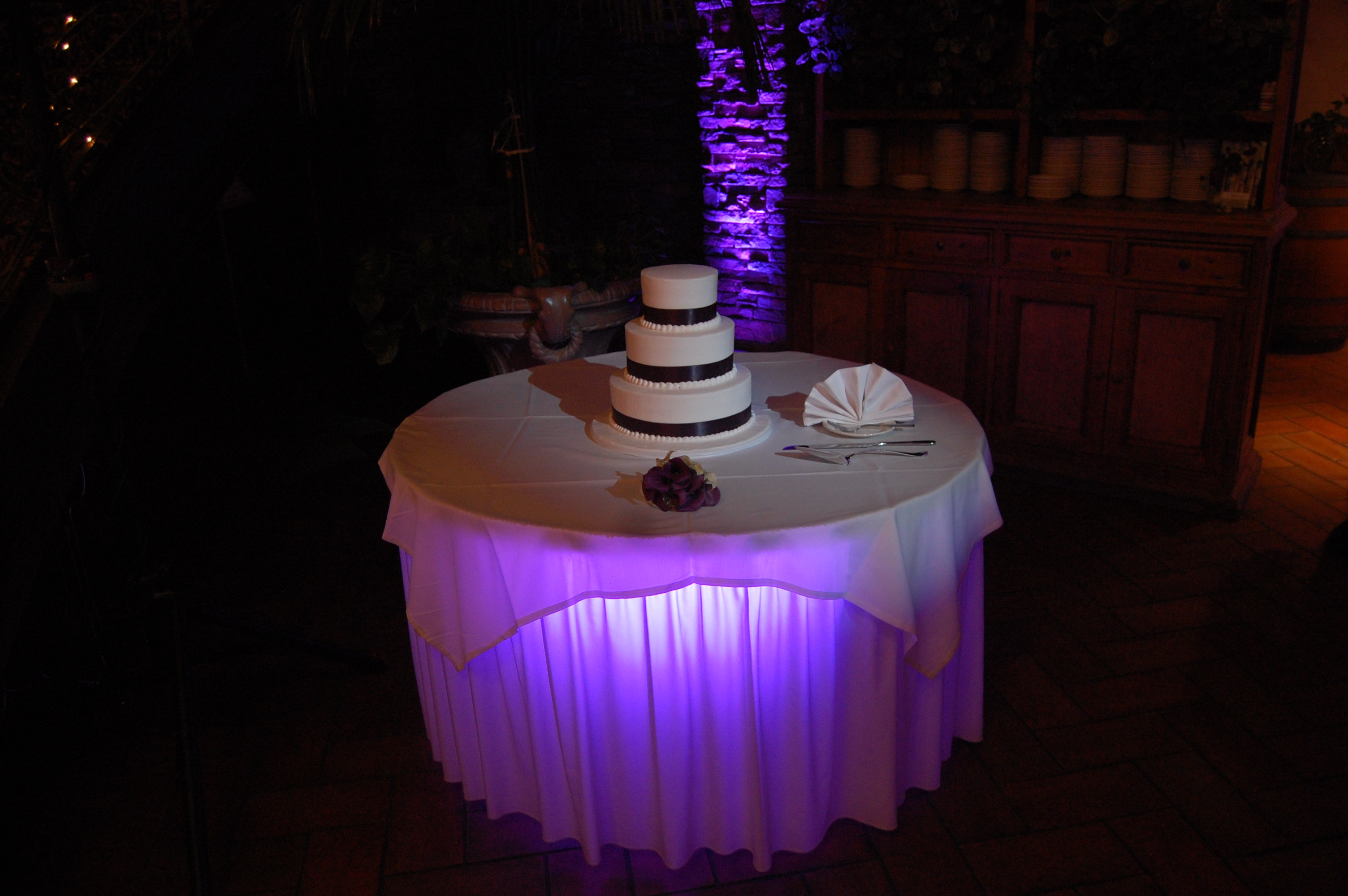 Cake pin spot with wireless led up light underneath table skirt
